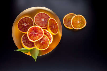 red sicilian oranges on the plate