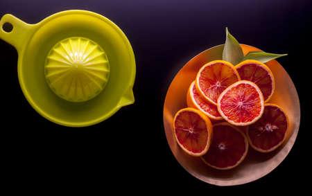 red sicilian oranges and squeezer Stock Photo