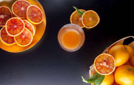 red sicilian oranges and glass