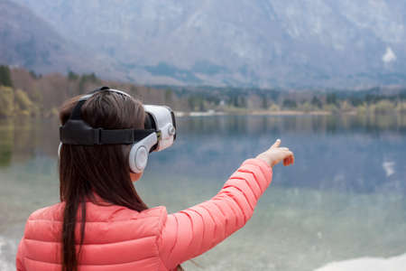 virtual reality simulator: young woman in VR glasses