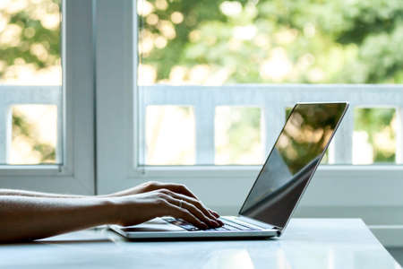 laptop computer female hands typing Stock Photo