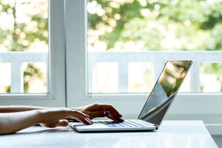 laptop computer with female hands typing