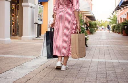 go shopping: woman outlet shopping concept