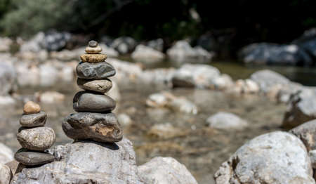 develope: balancing stones on the mountain river