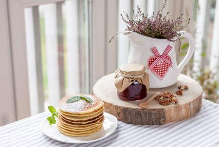 pancakes with plum jam delicious american breakfast Stock Photo