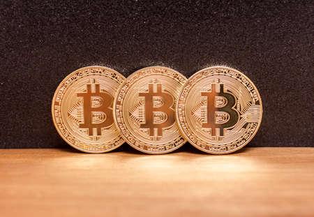 three golden bitcoin coins Stock Photo