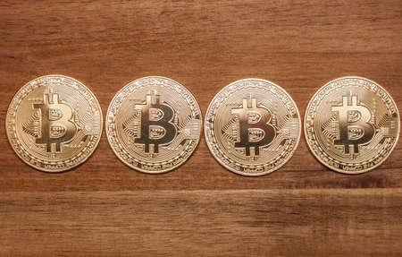 four golden bitcoin coins