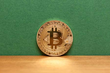 golden bitcoin coin green background