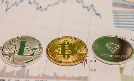 bitcoin ethereum litecoin coin and chart Stock Photo