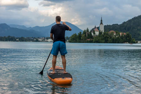 stand up paddle boarding on the lake Bled in Slovenia Imagens
