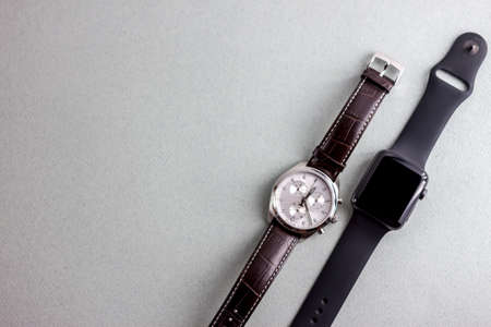smart and classic wrist watch on craft background