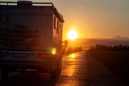 campervan on the road heading to sunset