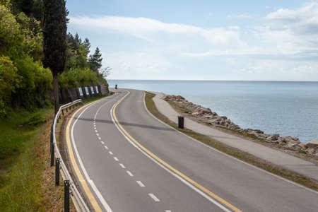 walking and biking asphalt way along seaside city park Reklamní fotografie