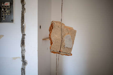 apartment renovation piece of wall hanging on reinforcement