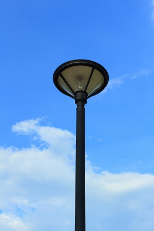 Lamp Post Street Road over blue sky  photo