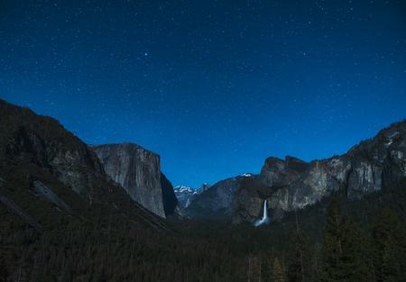 yosemite at night with star night sky background.