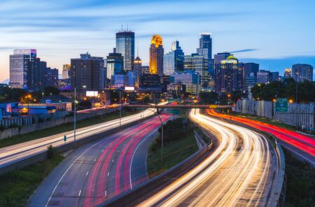 Minneapolis skyline with traffic light at night.