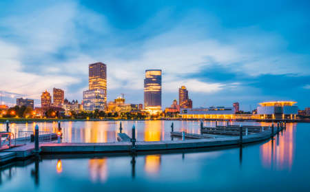 milwaukee skyline at night with reflection in lake michigan. Editorial
