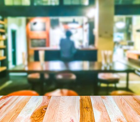 scene of wooden table top with abstract blurred background in open restuarant and bar.ready for product display montage..