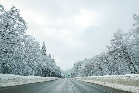 Empty road with high snow level covered landscape in winter season..