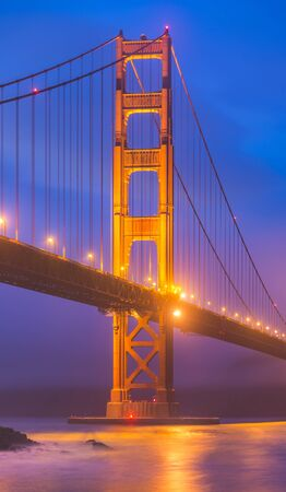 scenic view of Golden gate in the in the dusk with lighting and reflection on the water and fog,San Francisco,California,usa.