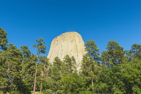 Devil towers against the blue sky in summer season,Wyoming,usa.