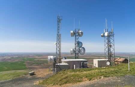 Telecommunication mast TV antennas on the sunny day.