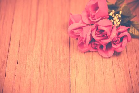 a bunch of rose on the wooden table top ,Ready for display montage,for valentine's day.