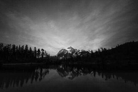 scenic view of mt Shuksan over with reflaction on the lake and on sunset,Whatcom County, Washington, usa.