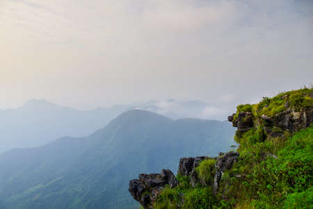 The Phu Che Fha Cliff before the sun shine  and the mist with mountain background very beautiful view Archivio Fotografico