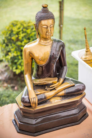 Buddha statue and his name is Jang ,Thai language at gold is a name of Pilgrim and at the basement is Luang phor Jang the name of statue Stock Photo