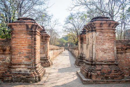 Ancient brick wall path way in old temple at Ayutthaya province.
