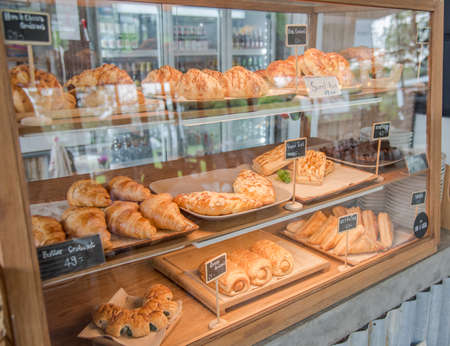 Croissant and bread and bun on shelf show for sale Stockfoto