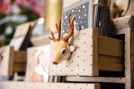 Deer hand grip on bookshelf Stock Photo
