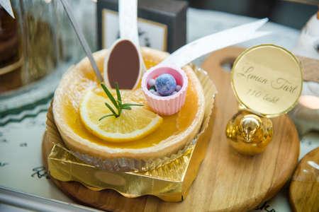 Lemon tart on the wooden plate in shelf for sale