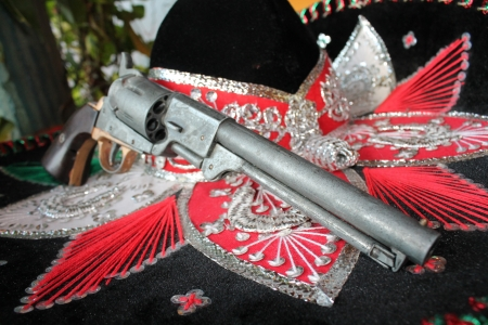 sequin and decorative ornate mexican hat ready for a fiesta with a gun photo