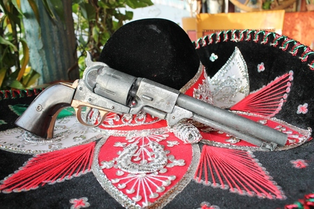 sequin and decorative ornate mexican hat with gun photo