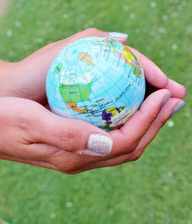 hands holding world earth globe photo