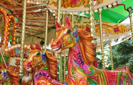 fayre: Vintage carousel merry-go-round painted horses - Stock Photo