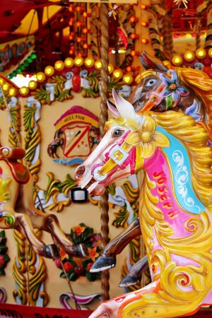 fayre: Vintage carousel merry-go-round painted horses Stock Photo