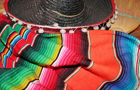 poncho: ornate mexican hat and poncho ready for a fiesta party