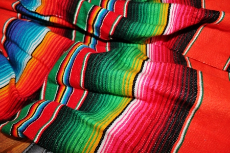 Traditional Mexican rug hand woven in bright colors for fiesta