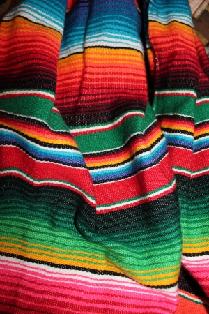 Traditional Mexican rug hand woven in bright colors  Stock Photo