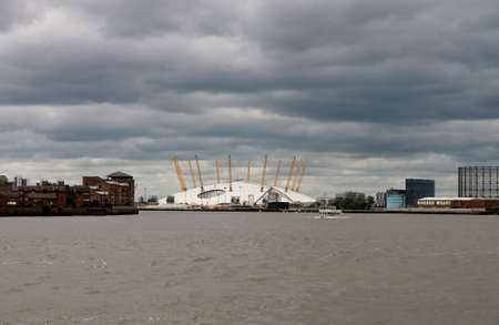 o2: Millenium dome across Thames with storm moving in