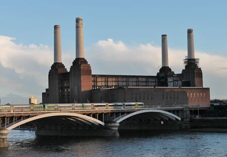 Battersea power Station on the River Thames, London London Battersea Powerstation, located in Wandsworth, was abandoned factory power station  This Iconic landmark is sold for 400 million pounds and being renovated for a shopping center   photo
