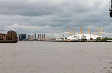 o2: Millenium dome across Thames with storm