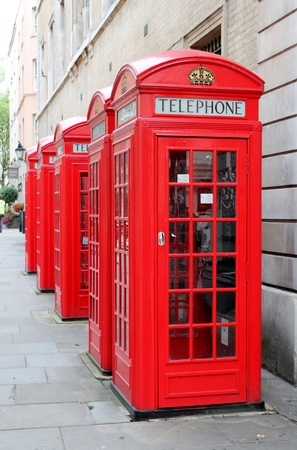 Classic red British telephone box London - Stock Photo photo