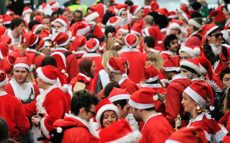 Annual Group crowd of santas in London Editorial