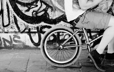 BMX Bike rider resting on his his bike   photo