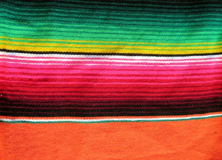 mexican handwoven rug poncho fiesta with stripes and bright colors photo